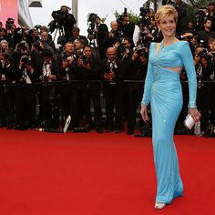 Jane Fonda, in Atelier Versace, with Chopard jewels, a Versace clutch and Jimmy Choo shoes.