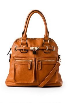 I own this tote and got it from ShoeDazzle in the camel color and black. Hands down great buy!