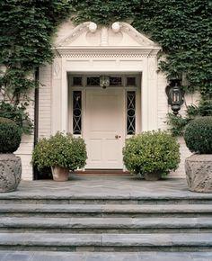 White brick, white door and ivy