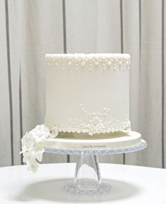 An ivory celebration cake with delicate hand piped details