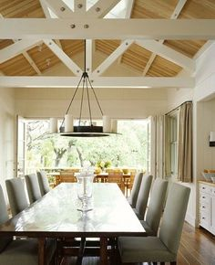stained/natural ceiling with painted trusses and beams