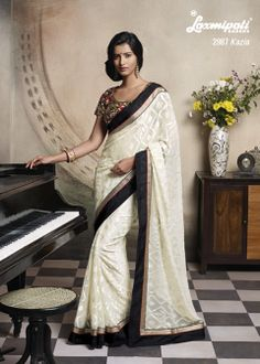 This Super-Duper brasso saree consists off remarkable Zari border, Resham Work & heavy embroidery blouse, angelic feeling for A Lady.