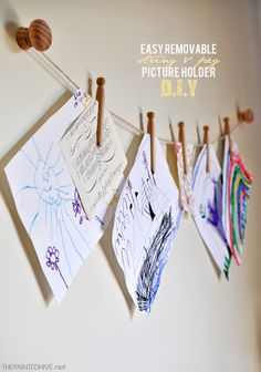 Easy DIY removable string and peg picture holder (no need for holes in your walls!) - nice temporary solution for displaying artwork or greeting cards, also great for renters or the just plain fickle minded! Great work thanks a lot. Hanging Kids Artwork, Displaying Kids Artwork, Diy Artwork, Artwork Display, Hanging Art, Pictures On String, Hanging Pictures, Deco Kids, Picture Holders