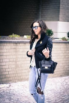va darling.   faux leather sleeve bomber jacket. destroyed denim. polka dot tights. reflective ray ban sunglasses. vintage brooch. casual brunch style.