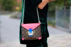 Spotted by photographer Craig Arend at #NYFW, Yuyu (YuyuFashionBook) carried this playfull Louis Vuitton Totem Pochette. As seen on NYTimes.com
