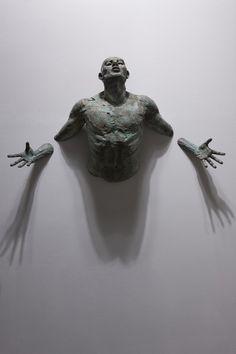 Juxtapoz Magazine - Matteo Pugliese's Sculptures Emerge From Walls