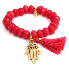 Fuschia Elastic Bracelet with Tassel and Gold Hamsa Charm