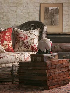 Giant old books piled as an alternative to a side/coffee table; Love Letter wallpaper - Andrew Martin; old world charm living room