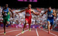Ashton Eaton of the United States wins in the men's decathlon 100-meter heat next to Brazil's Luiz Alberto de Araujo (left) and Ukraine's Oleksiy Kasyanov (right) on Aug. 8