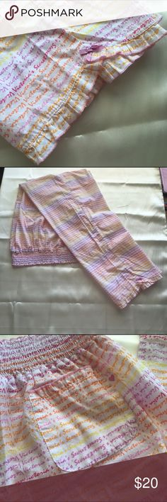 """🆕 Listing Adorable pajama pants! New without tags! Adorable and cool pajama pants featuring the VS signature print! They feature a wide elastic waistband, a cute pocket on the back, and Ruffled edge pants adorned with a sweet purple bow! The waist lying flat not stretched measures 13"""" (26"""" doubled) the inseam measures 30"""". 100% Cotton. Victoria's Secret Intimates & Sleepwear Pajamas"""
