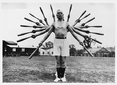 Men Exercising with Indian Clubs
