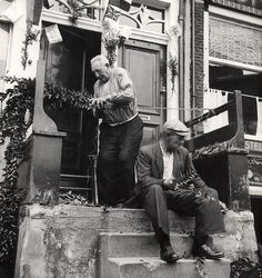 Word War II. Liberation of Holland. Men decorating their houses before the arrival of the liberators. Amsterdam, The Netherlands, May 1945.