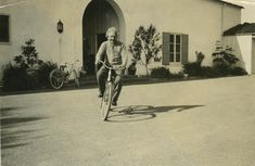 Albert Einstein riding a bicycle in front of Ben Meyer's House in Santa Barbara, California on February 6, 1933. Meyer was a California Institute of Technology trustee.