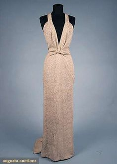 LUCIEN LELONG EVENING GOWN, 1937 Ivory silk & gold-flecked brocade, deep V front to midriff knot, twisted strap halter style back, exquisite bias piecing w/ hourglass center back seams decending to back train Vintage Glamour, Vintage Beauty, 1930s Fashion, Retro Fashion, Vintage Fashion, Madame Gres, Vintage Outfits, Vintage Gowns, Moda Vintage