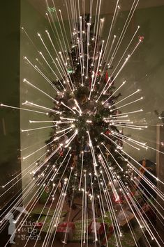 how to create beams of Christmas lights. Really simple! If you have an SLR you can do this!