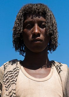 Portrait of an afar tribe man with traditional hairstyle, … | © Eric Lafforgue www.ericlafforgue.com  Flickr
