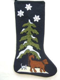 A special dog and/or cat is looking for a new home. Is yours ready? This adorable dog and cat stocking is made of black wool felt. Appliqued with wool felt and embellished by hand with Swarovski hot crystals, and distinctive black or white stitching is around each appliqued piece. There is no hand stitching visible on the inside of the stocking. The back of the stocking is plain black and there is a 3 hanger on the top. The stocking measures 18 by 11.    If you dont see what you are look...