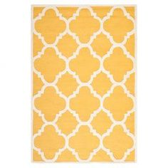 Hand-tufted wool rug in gold with a quatrefoil motif. Made in India.   Product: RugConstruction Material: WoolColor: Gold and ivoryFeatures:  Made in IndiaHand-tufted Note: Please be aware that actual colors may vary from those shown on your screen. Accent rugs may also not show the entire pattern that the corresponding area rugs have.Cleaning and Care: Professional cleaning recommended