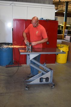 Welding table is hydraulic and on casters. Perfect for a welding shop or warehouse.