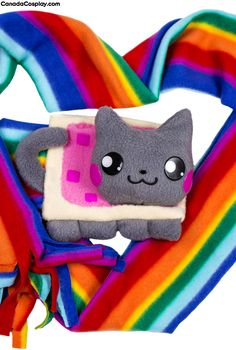 Nyan Cat Scarf - An Extra Long (extra rainbow) scarf has a cutle little pastry cat on one end. A simple and cute plush.