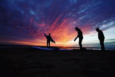 Patrick Lutz of Virginia Beach makes his way to the water as the sun starts to rise at Virginia Beach on Saturday morning March 19 2016. In the center is his father John getting ready to join him. On the right is Gabriel who decided it is too cold to get in the water. (Photo by Thé N. Pham) #sunrise #surf #photoshoot #photojournalism #photoaday #757 #virginianpilot #virginiabeach #virginia #HRVA by virginianpilot