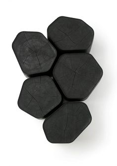 "Basalt / Ymer & Malta 2013 This 5 coffee tables burnt wood, called Basalt, comes from the same trunk of oak, cut and re-assembled to preserve only the rings formed by the heartwood, the noble part described as ""heartwood"" wood."