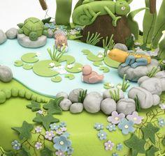 fondant garden cake, fondant pond cake, fondant lilly pad, fondant garden scene, fondant chameleon, fondant owl, fondant frog, fondant hedgehog, fondant rabbit, fondant flowers, fondant leaves, fondant bullrushes, fondant garden, fondant birds, fondant caterpillar, fondant leaves, fondant ivy, fondant grass Fondant Tree, Fondant Owl, Fondant Cakes, Fondant Flowers, Toddler Birthday Cakes, Dinosaur Birthday Cakes, Birthday Cakes For Men, Jungle Safari Cake, Safari Cakes