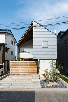 Metal skin wraps the exterior of Japanese house by Takeru Shoji Architects