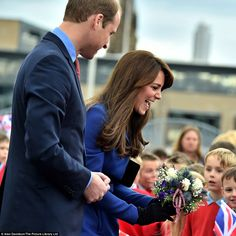 The Duchess was in high spirits as she was gifted bouquets by schoolchildren in Dundee...