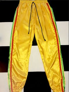 ♥V SOFT V SILKY BOOTY♥V PRECIOUS SLIM FIT TRACKPANT♥YELLOW SATIN FT. ORANGE AND GREEN STRIPES♥SIZE UP 4 A BAGGIER FIT♥MANNEQUIN WEARS SIZE S♥SATIN POLY BLEND♥NO STRETCH♥ELASTIC WAIST BAND W DRAWSTRINGS♥LIGHTWEIGHT
