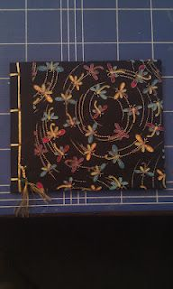 A Japanese stab bound handmade book with a dragonfly design