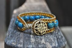 Wrapped Hemp Bracelet with Turquoise Ceramic & Gold Glass Beads - Boho, Bohemian, Stackable, Cuff, Beach, Wrap. $39.00, via Etsy.