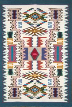 ancient weaving patterns | Navajo Rug by Lily Touchin - Jeweled Storm Pattern