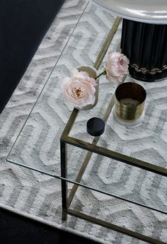 Wonderful decor with this beautiful table. Picture showing a close-up on Layered's classic  rug Labyrinth Gray Garden. Check out the brand for more graphic high quality rugs. Free worldwide delivery. See more at: http://layeredinterior.com/product/labyrinth/?attribute_pa_color=mocca_brown&image=lab_mb20160115