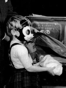 Mickey Mouse gas mask: On January 7th, 1942, one month after Pearl Harbor, T.W. Smith, Jr., the owner of the Sun Rubber Company, and his designer, Dietrich Rempel, with Walt Disney's approval introduced a protective mask for children. This design of the Mickey Mouse Gas Mask for children was presented to Major General William N. Porter, Chief of the Chemical Warfare Service. After approval of the CWS, Sun Rubber Products Company produced sample masks for review. Other comic book character des...