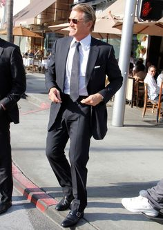 Dolph Lundgren Photos Photos - MR BLOND? Dolph Lundgren looks every bit the Resevoir Dog as he leaves Il Pastaio restaurant in Beverly Hills with a friend, pausing to give money to a man in a wheelchair. - Dolph Lundgren Leaves Il Pastaio