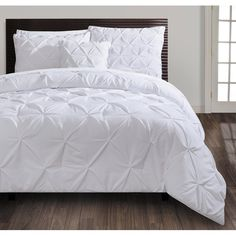 Add a touch of elegance to the master suite or guest room with this lovely comforter set, featuring a stylish pintucked design and white hue. Queen and King only