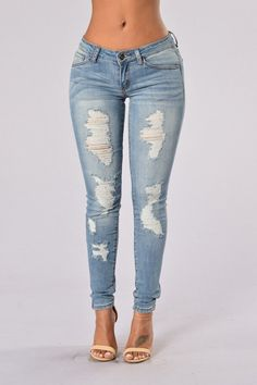- Available in Medium Blue - Mid Rise - 5-Pocket Design - Skinny Leg - Distressed - 75% Cotton, 20% Polyester, 3% Spandex