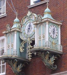 Gorgeous clock on the front of Fortnum and Mason ~ tea shop in London.... ᘡղbᘠ