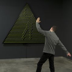 These interactive installations by artist Daniel Rozin use sensors and motors to rearrange objects into a mirror-image of whoever stands in front of them