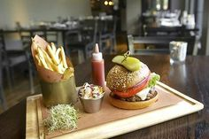 Burgers take on unusual preparations at Republic, such as the Au Poivre, with caramelized onion, Swiss cheese and cognac cream sauce.