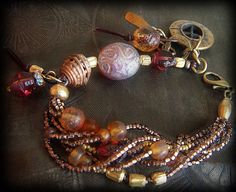 Glass, African Brass and Old World Czech Glass Beaded Leather Charm Bracelet. $51.00, via Etsy.