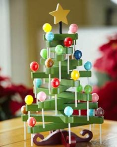 Clothespin Lollipop Tree  So cute! Could even do as a countdown to Christmas or as an Advent Calendar.