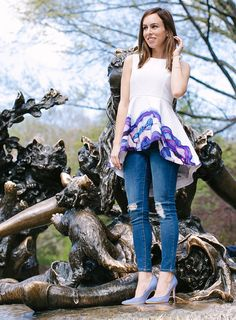 Sydne Summer styles a t-shirt dress with an abstract print, paired with distressed jeans, at the Alice in Wonderland sculpture in Central Park.