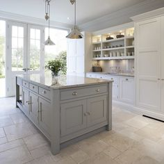 Pale grey units with white wall units in shaker style gives an open feel and works well with gloss marble worktop and pale flooring with surface details to camouflage any sweepings before they are dealt with!