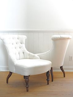 Love the English shape of these white linen chairs.