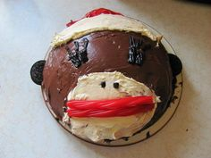 My version of the sock monkey cake. Made this for Ellie's B-day. It actually was really easy and FUN!