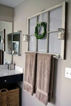 mirrored old window in bathroom for towel rack?