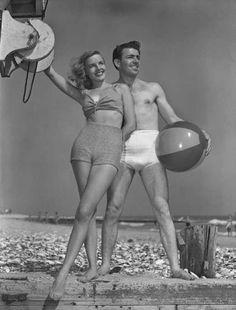 Couple on the beach, circa 1950