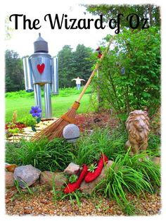 Our Wizard of Oz themed garden, Scarecrow, Tin man, Lion and Dorothy's ruby slippers